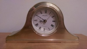 Shiny brass analog clock.