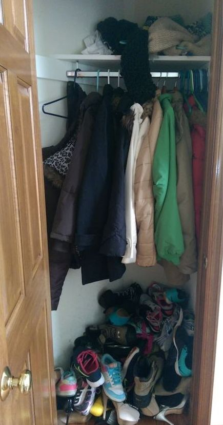 Cluttered Closet Full Of Shoes, Coats, And Other Stuff.