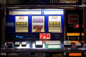 Slot machine with bars and 7s.
