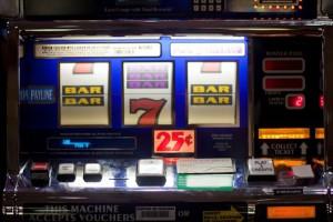 Slot machine with bars and 7s.