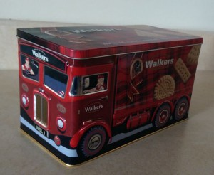 Cookie tin decorated like a delivery truck.