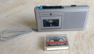 Mini tape recorder with cassette.