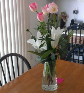 Flowers in a glass vase on the kitchen table.