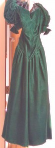 Long green velvet dress with short puffy sleeves.