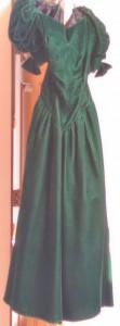 Long green velvet dress with short puffy sleeves.