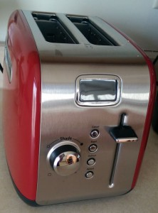 New red toaster with display screen.