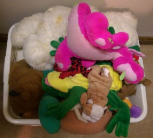 Stuffed animals in a basket.