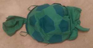 Child's green turtle costume.