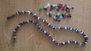 Necklace of crystal beads with a broken plastic string.