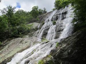 Waterfall over steep, slippery rocks.