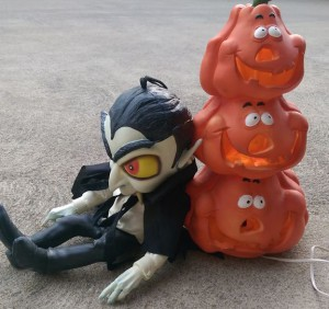 Plastic jack-o-lantern with vampire doll.