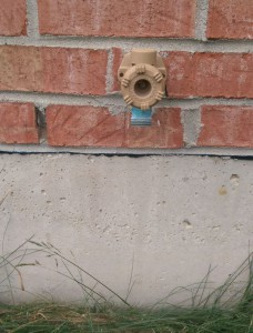 Spigot set into red bricks on the side of my house.