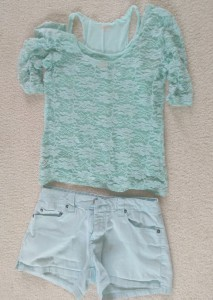 Light blue summer clothes set, with cotton shorts and a lace top layered over a tank top.