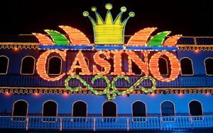 Bright neon casino sign at night.