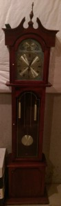 Broken grandfather clock in the basement.