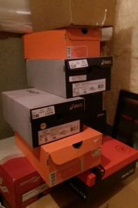 Stack of shoeboxes in a corner of the basement.