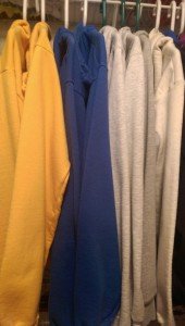 Hoodie sweatshirts on hangers in my closet.