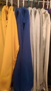 Hoodie sweatshirts on hangers in my closet.