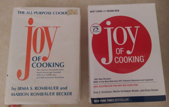 "An old ""Joy of Cooking"" next to a newer one."