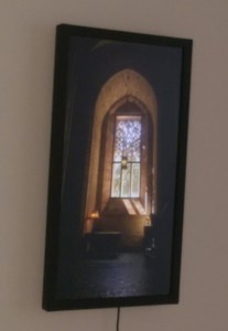 Flat-screen display showing a church window with a dark and quiet area beneath.