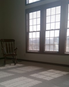My living room with open wooden blinds on a hazy day.