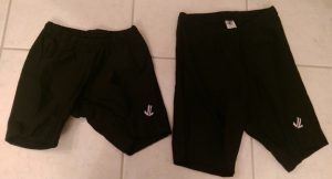 Two pairs of black rowing shorts, women's and men's.