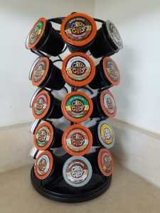 "K-cup carousel with assorted ""Crazy Cups"" decaf."