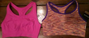 Two new sports bras with the tags still on.