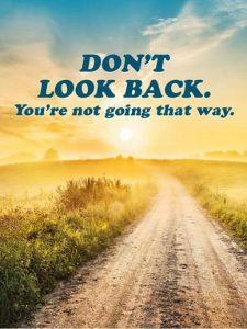 """Word-art that shows a path at sunset and says """"Don't look back. You're not going that way."""""""
