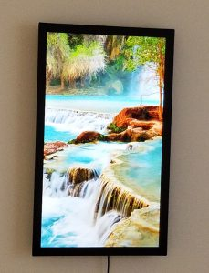 Photo of digital art display with picture of Lake Havasu