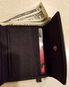 Wallet with edges of small bills showing.