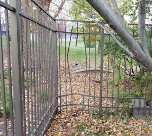 Aluminum fence broken by a deer.