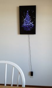 Animated art of a purple Christmas tree with sparkling stars.