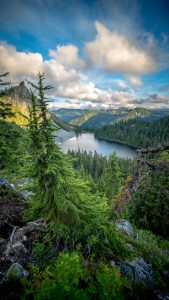 Photo of Lake Valhalla in Washington, with forested hills.
