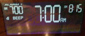 "Alarm clock displaying 7:00 AM and ""beep"" indicator."