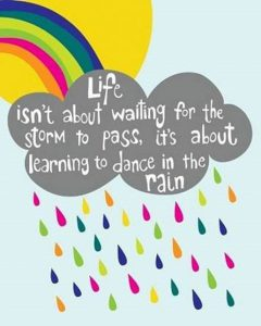 "Word-art that says ""Life isn't about waiting for the storm to pass, it's about learning to dance in the rain."""