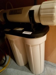 Reverse osmosis filter unit under the kitchen sink.