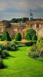 Manor house with garden in foreground.