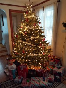 Brightly lit Christmas tree with presents