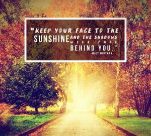 """Word-art that says """"Keep your face to the sunshine and the shadows will fall behind you."""" -Walt Whitman"""