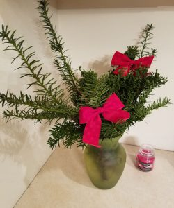 Juniper and yew branches with red holiday bows.