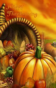 Happy Thanksgiving image with a pumpkin and horn of plenty.
