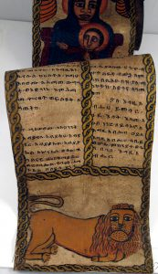 Ancient parchment prayer scroll with illustrations.
