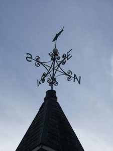 Weathervane showing the four directions.