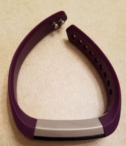 Fitbit with small purple band.