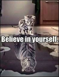 "Word-art with a kitten seeing its reflection as a tiger; it says ""Believe in yourself."""