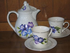 Tea set for two with floral pattern.
