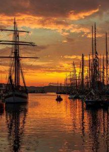 Ships under a sunset sky.