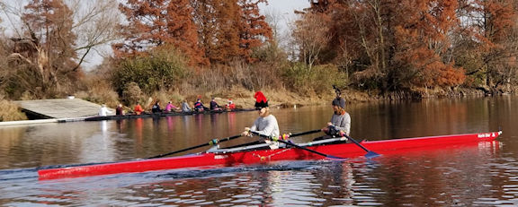 Two crews on the river. A double is in the foreground and an 8+ is in the background.