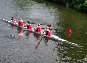 College women rowing a four.